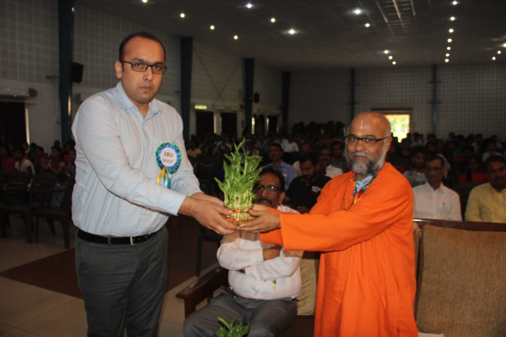 Induction :MR MANISH KUMAR MANAGER P & A  FELICITATING Guest of honor Swami Madhavanand ji